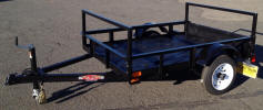 "Custom 4 x 6 Light Weight Trailer with 2,000 GVWR, 2,000lb. Slipper Suspension Axle, 3x2x3/16 Angle Frame, 3x2x3/16 Angle Tongue, 12"" / 5 on 4.5 Tires & Wheels, 2"" A Frame Coupler with caster Wheel, 2,000lb Jack, 2 x 8 Drop in Rear, 3'10"" Removable Racks, 6 -3/8in D rings, 4 - Rope Hooks, Painted Trailer Undercarriage"