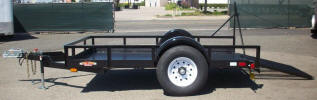 "77 x 10 Custom Standard Utility Trailer Built with 6,000lb. GVWR, 6,000lb 4"" Drop Axle, 235-80R16 Tires & Wheels, 2 5/16"" Hydraulic Coupler, 2,000lb Jack, Diamond Plate Deck, 4- D Rings, Z Tongue, Heavy Duty Frame, Spring Assist, 4' Wide x 4"" Long Ramp Gate on Right Side, Painted Trailer Undercarriage"