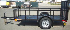 "Custom 5x10 Standard Utility Trailer with 2,990lb. GVWR, 3,500lb Axle, 15"" / 5 on 4.5 / 4 Ply Tires & Wheels, 2"" A Frame Coupler, 2,000lb Jack, 2 x 2 Angle Top Rail at 24"", Ramp"