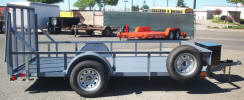 "Custom 6.5 x 12 Standard Utility Trailer with 2,990lb. GVWR, 2"" A Frame Coupler, Equalizer/Leaf Spring Suspension, 15"" / 5 on 5 / 4 Ply Tires & Wheels, 2,000lb. Jack, 3 x 2 x 3/16 Angle Top Rail, Z Tongue, Steel Box on Tongue, Fold up Jack with Wheel, Spare Tire and Wheel, Spare Tire Mount, 6- 1/2"" D Rings, 2- Stabilizer Stands Rear, Ramp Gate, Spring Assist, Painted Trailer Undercarriage Medium Gray"