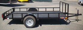 "77"" x 12' Single Axle Standard Utility Trailer with 2,990lb GVWR, One 3,500lb Axle, Front Cross Bar 48"" From the Ground, 2,000lb Jack, Tubing for Drop in For Rear of Trailer, 15"" Tire and Wheels Silver Modular, 2"" A Frame Coupler, 2 x 2 Angle Top Rail, 3"" Channel Tongue, Painted Trailer Undercarriage"