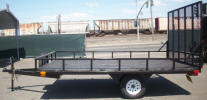 "8 x 12 ATV Trailer Built with 2,990lb GVWR, 3,500lb Axle, 1 ½"" Square Tubing Frame, 13"" 5 on 4 ½ Tires & Wheels, 8"" Rail Side Rail, 4- D Rings, 5' Gate, Spare Tire Mount, Painted Trailer Undercarriage"