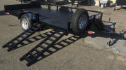 "77 x 12 Side Load ATV Trailer with 2,990lb GVWR, Single 3,500lb Axle, 1 ½"" Square Tubing Frame, 13"" 5 on 4.5 Tires & Wheels, 8"" Side Rail, 2"" Coupler, Spare Tire Mount, Spare Tire and Wheel, Caster Wheel, Diamon Plate Guard on Fender, 8 - 1/2 D Rings, Drop in Board on Rear, Painted Trailer Undercarriage"