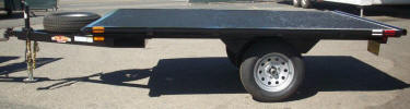 "7' x 10' Flat Bed Custom Built with 2,995lb GVWR, 3,500lb GVWR Axle, 175-80-D13 Tires and Wheels, 36"" Tongue, Tie Bar Rail All Around,2"" x 2"" Cross members, 2"" x 4"" Main Frame Tubing, 2"" Coupler with Safety Chains, A Frame Jack, Douglas Fir Decking"