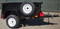 "4 x 6 Custom Jeep Trailer Built with Spare Tire and Rim Mounted, Jeep Fenders, 6 Pockets 10 1/2"" Hooks, Swivel Jack with Caster, Mounted Can Holders Shown with Upgrade Options."