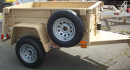 "4 x 6 Custom Jeep Trailer Built with 2990lb. GVWR, 3,500lb. Electric Braking Axle, 2"" A Frame Coupler, Safety Chains, 2,000 lb. Swivel Jack, 15"" 5/5 Rated Tires & Wheels, 2 x 10 Douglas Fir Deck, 24"" Formed Sheet Metal Sides, 24"" Metal Rear Drop Down Gate, 14 - 1/2"" Hooks, 6- Pockets, Plate on Tongue, Spare Tire and Wheel Mounted, Painted Trailer Undercarriage"