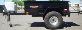 "5' x 7' Custom Jeep Trailer Built with 2,990lb GVWR, 3,500lb GVWR Axle, 2"" x 2"" Cross-members, 2"" x 4"" Main Frame Tubing, Pental Eye with Safety Chains, Swivel Jack with Foot, 8' Wide, Customer's Tire and Wheels, Douglas Fir Decking, 24"" Sides, 1/2 Rope Holders, 1/2"" D- Ring in Front, Spare Tire Mount, Gate on Back 24"", Ramp Holders, Painted Trailer Undercarriage"