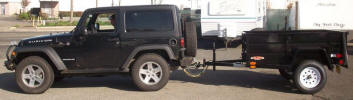 "Custom 5 1/2 x 6 1/2 Jeep Trailer with 2990lb. GVWR, 3,500lb. Electric Braking Axle, Pintle Eye, 2,000lb. Tongue Jack, 15"" 5/5 Rated Tires and Wheels, 2 x 10 Douglas Fir Deck, 24"" Formed Sheet Metal Sides, 24"" Metal Rear Drop Down Gate, Painted Trailer Undercarriage, Spare Tire and Wheel, Spare Tire Mount, Breakaway Kit, 7 Way Plug, 10- Tie Down Hooks."