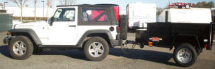 "4 x 6 Custom Jeep Trailer with 2990lb. GVWR, 2"" A Frame Coupler, 2,000 lb. Swivel Tongue Jack, 15"" 5/5 Rated Tires and Wheels, 2 x 10 Douglas Fir Deck, 3,500lb. Axle, 4"" Formed Sheet Metal Sides, 24"" Metal Rear Drop Down Gate, Painted Trailer Undercarriage, Spare Tire and Wheel, Spare Tire Mount, 1/2 Rope Hooks, 1/2 D Rings, Receiver on Back, Tounge Box"