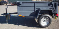 "Custom 4 x 6 Jeep Trailer with 2,990lb. GVWR, 2 5/16"" A Frame Coupler, 2,000 lb. Tongue Jack, 15"" 5/5 Rated Tires & Wheels, 2 x 10 Douglas Fir Deck, 3,500lb. Axle, 24"" Formed Sheet Metal Sides, 24"" Metal Rear Drop Down Gate, Painted Trailer Undercarriage, 4- 1/2 Rope Hooks Two each Side, 8 Pockets"