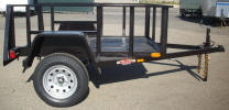 "54"" x 6'6"" Economy Jeep Trailer with 2,995lb GVWR, 3,500lb Axle Swivel Jack with Caster Wheel, Tail Gate Drop In Slips, 15"" Tires and WheelsShown with Upgrade Options."