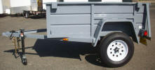 "Custom 54"" x 6'6"" Jeep Trailer with 2,990lb. GVWR, 3,500lb Axle, 2 5/16"" A Frame Coupler, 2,000lb. Tongue Jack, 15"" 5/5 Rated Tires & Wheels, 2 x 10 Douglas Fir Deck, 3,500lb. Axle, 24"" Formed Sheet Metal Sides, 24"" Metal Rear Drop Down Gate, Light Grey Painted Trailer and Undercarriage, 4 - Pockets, 4 - Rope Hooks, 7 Way Plug, Swivel Jack"