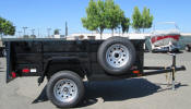 "Custom Jeep Trailer 50 x 97.5 with 2,990lb GVWR, Single 3,500lb Axle, 2"" A Frame Coupler, 2,000 lb. Tongue Jack, 15' 5/5 Rated Tires & Wheels, 2 x 10 Douglas Fir Deck, 24"" Formed Sheet Metal Sides, 24"" Metal Rear Drop Down Gate, Painted Trailer Undercarriage, Spare tire and Wheel, Spare Tire Mount, 10- Pockets, 6- 1/2 Rop Hooks"