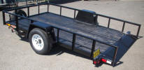 "82 x 12 Custom Tilt Bed Trailer with 5,200lb. GVWR, 5,200lb 4"" Drop Axle, 15"" / 5 on 4.5 / 4 Ply Tires & Wheels, 2"" A Frame Coupler, 2,000lb Jack, Heavy Duty Frame, Painted Trailer Undercarriage, Breakaway Kit, Extra Wide 82"" Between Wheels, Knife Edge, Gravity Tilt, 4- 1/2"" D Rings, Spare Tire Mount, Z Tongue, Spare Tire and Wheel"