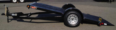 "Custom 70"" x 12' Tilt Trailer with 3,500lb GVWR, 3,500lb 4"" Electric Drop Axle, 15"" Tires, Z Tongue, Breakaway Kit, 7 Way Plug, 4-1/2"" D Rings, Knife Edge, No Rails, 5"" Frame Channel, 5"" Channel Wrap Around Tongue, 2"" x 6"" Wood Decking with Diamond Plate Tapered End, 2,000lb A Frame Jack, 2"" A-Frame Coupler with Safety Chains, 8'6"" Overall Wide, 80"" Between Fenders, Tilt Cylinder, Painted Trailer Undercarriage"