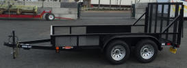 "77"" x 12' Standard Utility Style Trailer with 7,000lb GVWR, 2 5/16"" A Frame Coupler, Equalizer/Leaf Spring Suspension, 15"" / 5 on 5 / 4 Ply Tires and Wheels, 2,000lb Jack, 3 x 2 x 3/16 Angle Top Rail, 4"" Channel Tongue, Painted Trailer Undercarriage, Electric brakes one axle, breakaway kit, 7 way plug, 2-5/16 coupler, 4' gate, wrap around tongue, 4"" drop axles, Z tongue, spring assist both sides of gate, LED flush mount lights, caster wheel, 2"" square tube toprail, 1/8"" diamond plate floor, 4 - 1/2"" D rings, radial tires, 2x4 uprights in ramps at 58"" center"