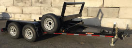 "96"" x 12' Custom Tiltbed Trailer with 9,995lb GVWR,Two 5,200lb Electric Braking Axles, Diamond Plate Decking, 3,500lb Mini Drop Leg Jack, 2 5/16"" Adjustable Coupler with Safety Chains, Cushion Tilt Cylinder, Breakaway Kit, Painted Trailer Undercarriage, Diamond Plate Fenders, Spare Tire and Wheel, Spare Tire Mount, Extra High Stoprail"